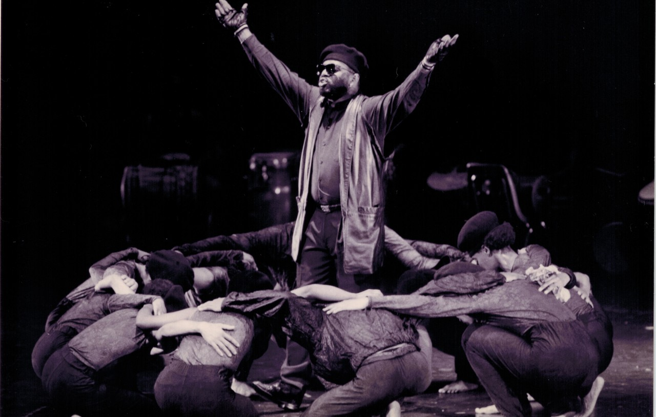 Dimensions Dance Theater performs Revolutionaries Circle, from the company's first Project Panther production, in 1996. Photo courtesy of Dimensions Dance Theater. Pictured: Ulysses Cooperwood (at center), and company dancers
